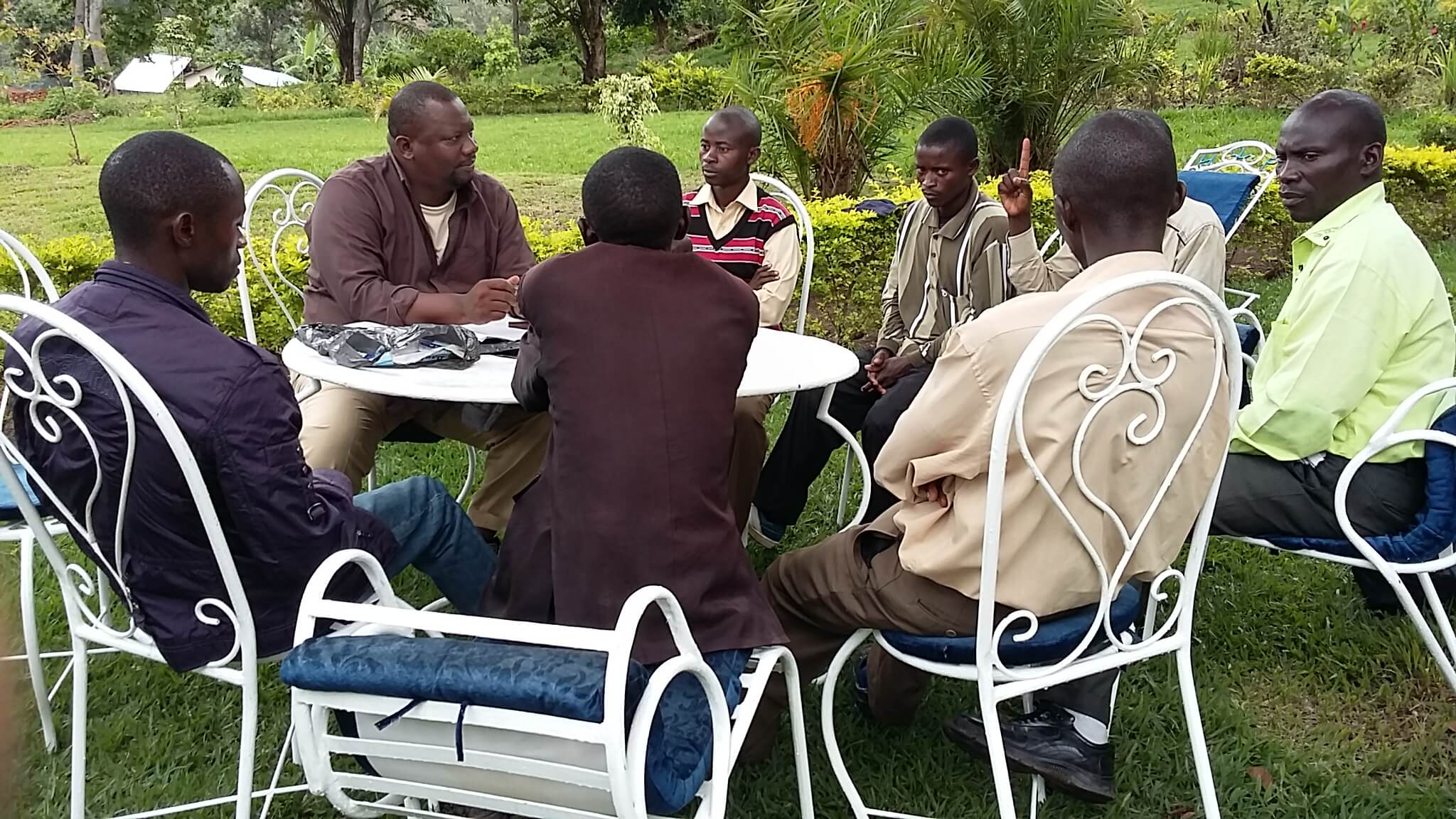 """Dr Augustin K. Basabose, PEx Executive Director meeting with local youth at Idjwi Island, members of """"Initiative pour la Restauration et la Conservation des Forets d'Idjwi (IRCFI)"""", a community based organization aiming to restore and conserve Idjwi forests."""